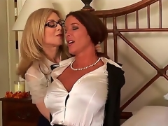 Very pretty and very busty whores Nina Hartley and Rachel Steele are engaging in a hot sapphic encounter and they look incredibly hot in the process.