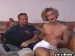 Sexy slim mature brunette milf with small tits and fit body in short white skirt and undies has fun with her filthy neighbor and takes on his beefy jock in living room