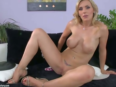 Tanya Tate is one perfect bodied milf babe with huge wobblers and bubble ass. She pulls off her belt panties and then gievs a closeup view of her hairless pussy. This hawt buxom milf shows it all