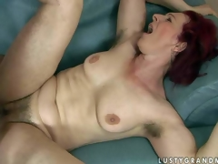 Debra is a fuck hungry red-haired older woman with curly pussy and unshaved armpits. She receives her muff fucked hard by thick dicked boy. She takes his juvenile sturdy dick deep in her vagina before he shoot discharges his load