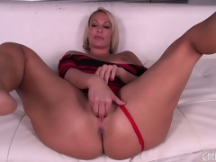 Mellanie Monroe spreads her legs wide open and works on her pussy