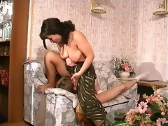 Nasty milf undressing a shy guy and seducing him into his first intercourse